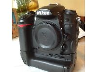 Nikon D7000 body with battery grip and two batteries