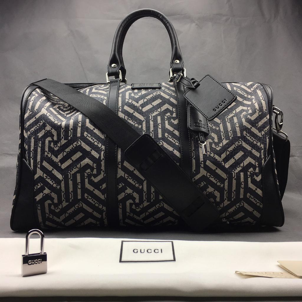 a453be486ed GG caleido travel duffle with embossed Gucci zip closure cross body bag  DISCOUNTED 499.99 ONVO