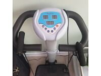 Vibrapower Exercise Machine. Including Instruction and Exercise Manuals.