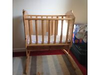 Hand crafted wooden swinging crib
