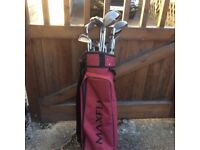 Golf bag with assorted clubs for sale