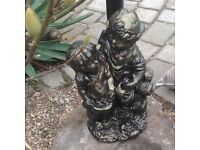 Beautiful bronze effect boy and girl statue