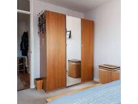 Three door wardrobe, including mirrored door