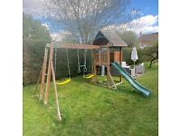 kids wooden climbing frame with swings and slide