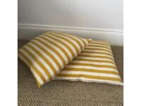 Two stripped scatter cushions