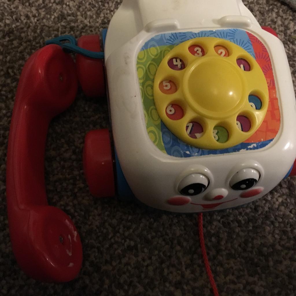 Children's toys, phone, clock and dinosaur game