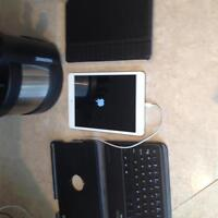 16 GB iPad Mini with keyboard and two cases