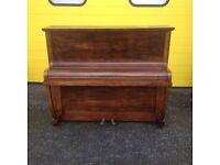 Piano upright in Mahogany style case.