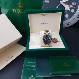 Two tone Rolex Submariner , black Face. Comes Rolex Bagged, Boxed with Paperwork.