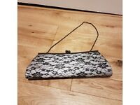 Small black lace clutch bag