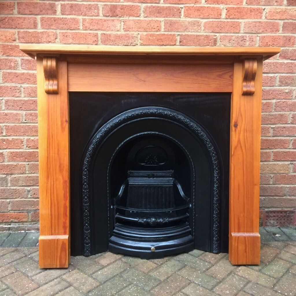modern cast iron fire place real coal fire or gas fire with wood