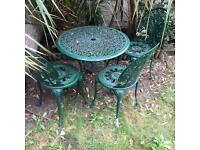 Beautiful cast garden table and chairs