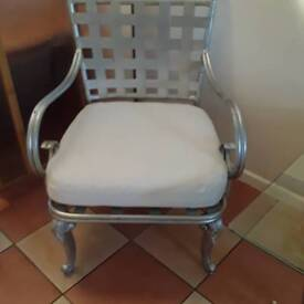 Good size metal chair with washable cover and matching glass table