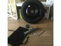 spare car wheel and jack