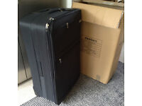 Suitcase BRAND NEW in packaging - with wheels and locking -Good Quality - XL