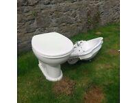 Wash hand basin and back to wall toilet bowl.