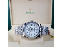Silver Rolex DateJust with White Face Comes Rolex Bagged and Boxed with Paperwork