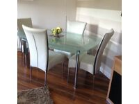 Harvey's Boat Glass Dining Table & 4 Marilyn Chairs