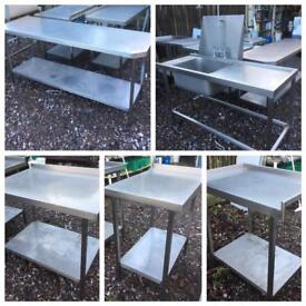 Assorted stainless steel catering prep tables