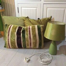 Green cushions and table lamp