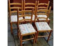 5 dining chairs. Light pine wood frame. Cushioned upholstery seat. In very good condition.