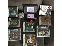 As new Nintendo DSi XL plus 8 games