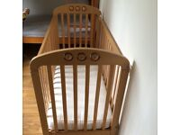 Used cot in beech with mattress