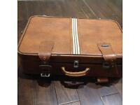 Old style tan leather look suitcase