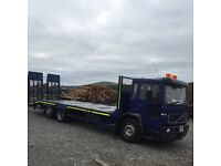 05 Volvo beavertail 23,000 gross , 11 months test , great going truck , bigger truck forces sale