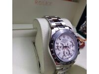 Silver Rolex daytona white face and black ceramic bezel comes complete with bag box and papers