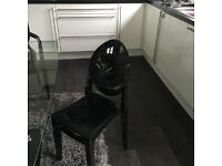 Glass dining table and 2 black chairs
