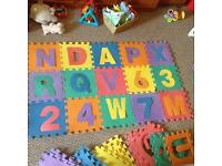 31 foam tiles with letters