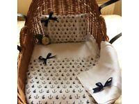 White and navy crib set