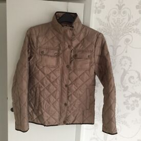 Lightweight padded jacket. Size 12. Excellent condition.