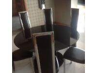 Black leather round 6 chairs dining table