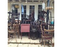 An assortment of 30 plus pub chairs and stools
