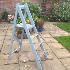 Painted wooden stepladders. Ideal for displaying plants in the garden or books in the house.
