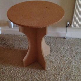 Circular piece of plate glass together with mdf table