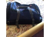 Suitcase with soft top half and firm suitcase bottom half.