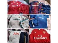 Kids football kits man u and arsenal
