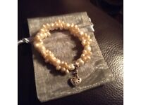Thomas Sabo pearl bracelet and silver heart charm.