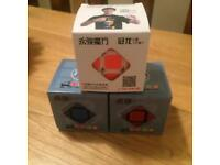 3 Rubik's Cubes.