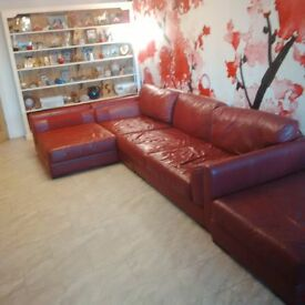 Very large Red Leather corner sofa and stool