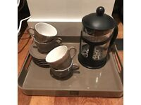 French press with coffee cups and tray