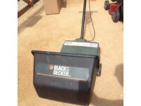 Lawn scarifier for removing moss