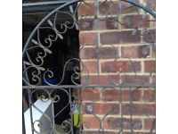 Wrought iron garden gate. Requires protective coating. Gate is approx. 6ft in height