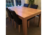 Beech effect table and four chairs.