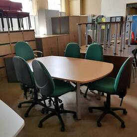 Used boardroom conference table in beech with 6 green chairs