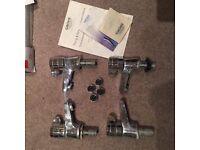 Two pairs of petit basin pillar taps