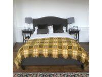 kingsize grey wool upholstered bedstead